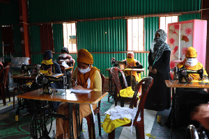 Rohingya women engaged in the production of masks in UN Women-AAB Multi-Purpose Women Centre to protect their community  from COVID-19 and earn an income to support their families.
