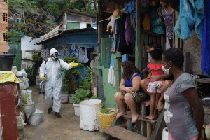 Residents of the Santa Marta favela in Rio de Janeiro during street cleaning to prevent the spread of COVID-19.