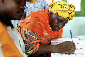 A woman signs a document certifying her vote in Côte d'Ivoire's legislative elections, at a polling station in Bondoukou in December 2011. ECOWAS deployed a mission of 60 observers from 8-13 December 2011 to oversee this election, which took place at a crucial time in the stabilization process of the country.