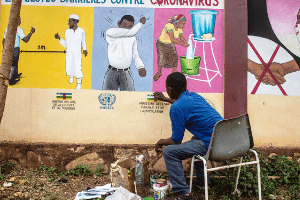 Central African painters contribute through a series of wall frescoes in the 8 districts of the capital